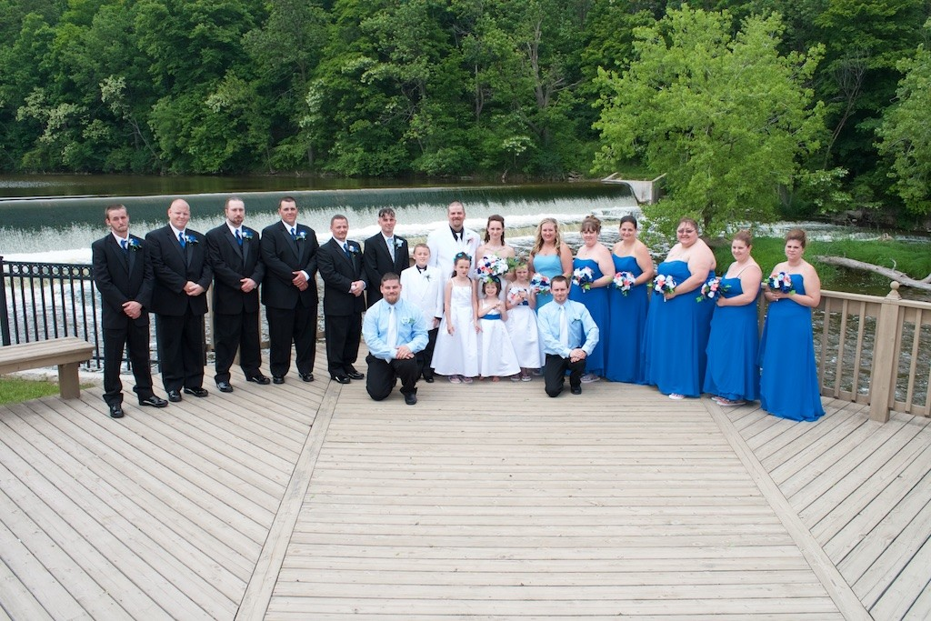 Bride and Groom with their Wedding Party Outdoors on a Deck by a River in Sheboygan Falls, WI