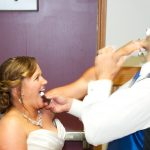 Katie & CJs Sheboygan Wedding - Bride and Groom feeding each other cake at the reception