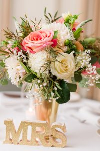 Wedding Reception Details. Bouquet of flowers on head table. MRS
